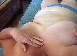 Wife relaxing while watching TV